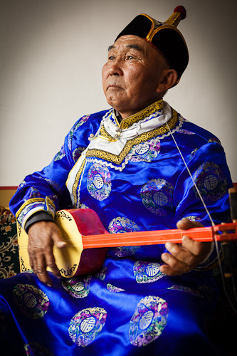 Man playing traditional mongolian instrument